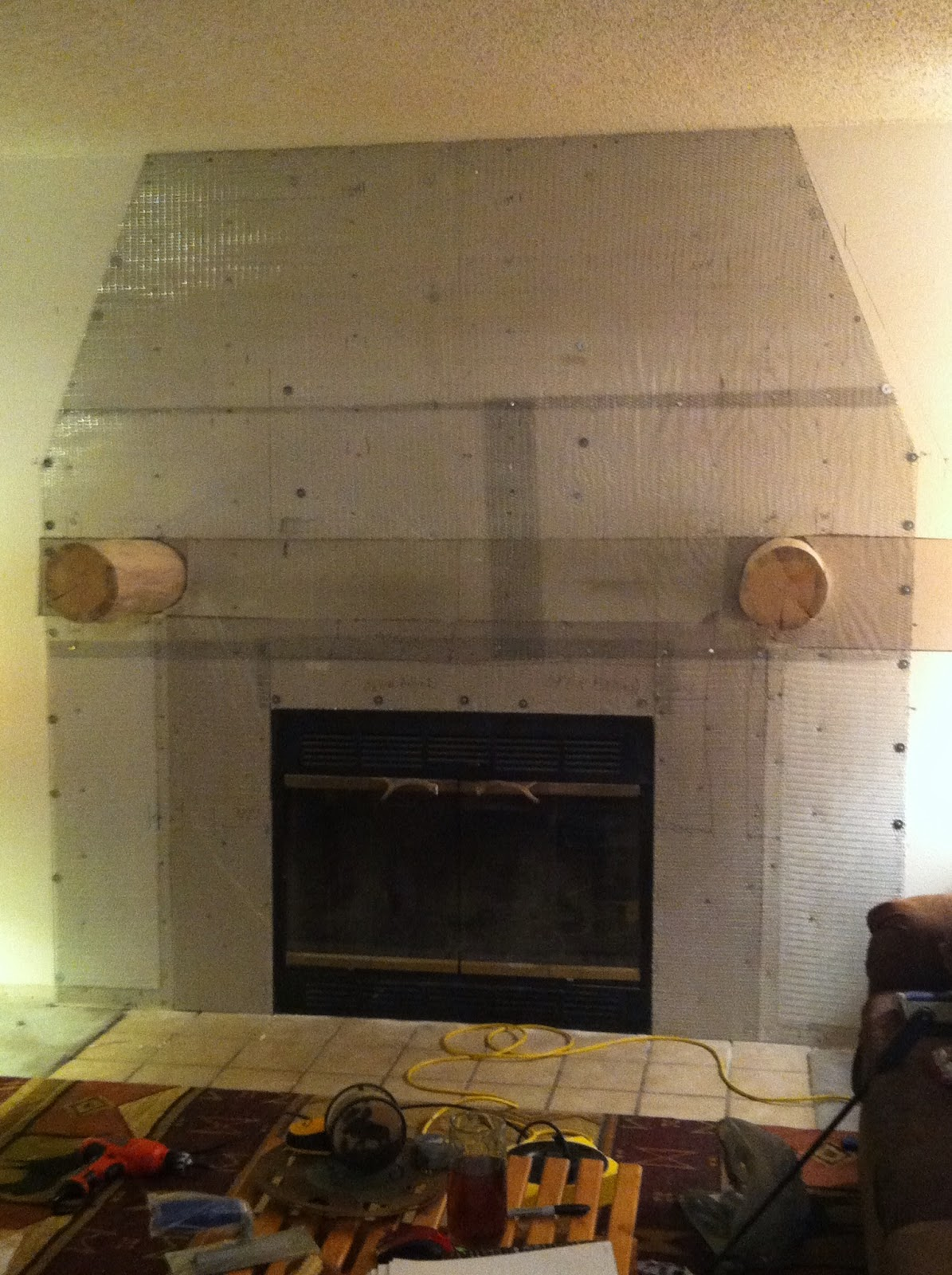 installing a log mantle over fireplace