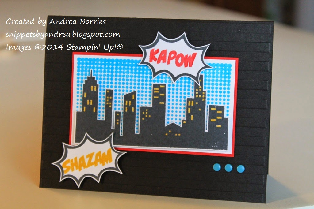 "Black card with embossed striped background and retro comic-style images of a skyline and ""shazam"" and ""kapow"" in action bubbles."