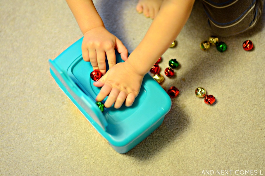 Fine motor Christmas busy box idea using jingle bells from And Next Comes L