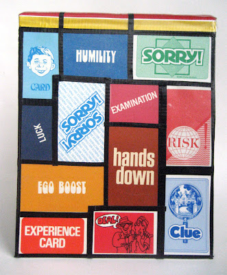 Cards from old board games upcycled into cool book cover