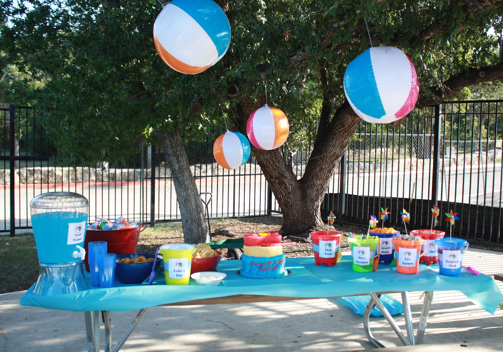 Mom swim bike run nicholas 39 9th birthday party a pool party for Pool decorations