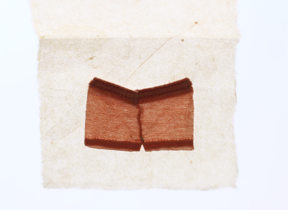 Boyshorts [2009], Little Undies series, ongoing. fabric & thread. 3.7 x 5.5 cm