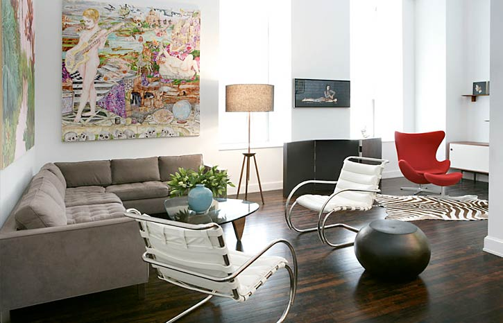 The Large Square Paintings Over Sectional Are Perfectly Proportional But Im Not Sure Why There Is A Huge Buckeye In Middle Of Floor