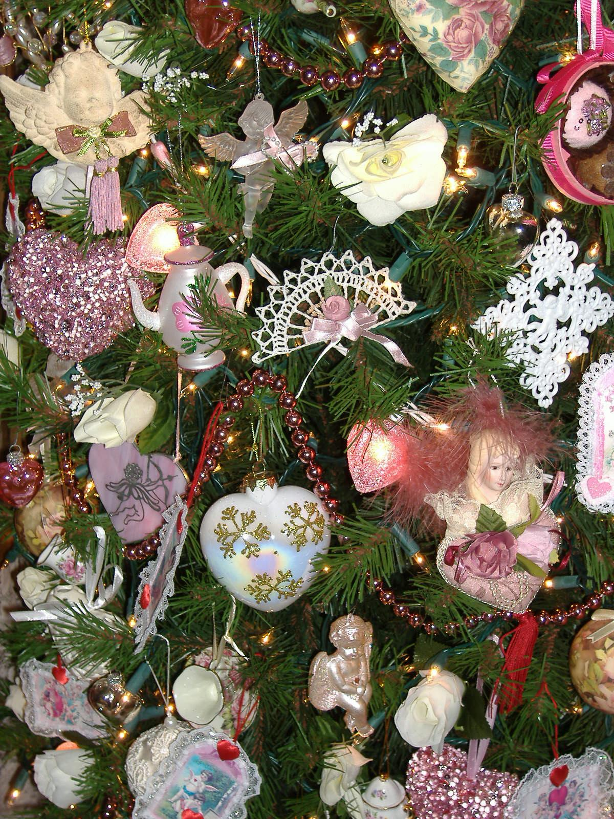 i set up a small white feather tree adorned with silver pink and gold hearts - Year Round Christmas Tree
