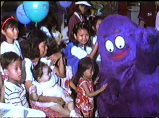 grimace playing with children