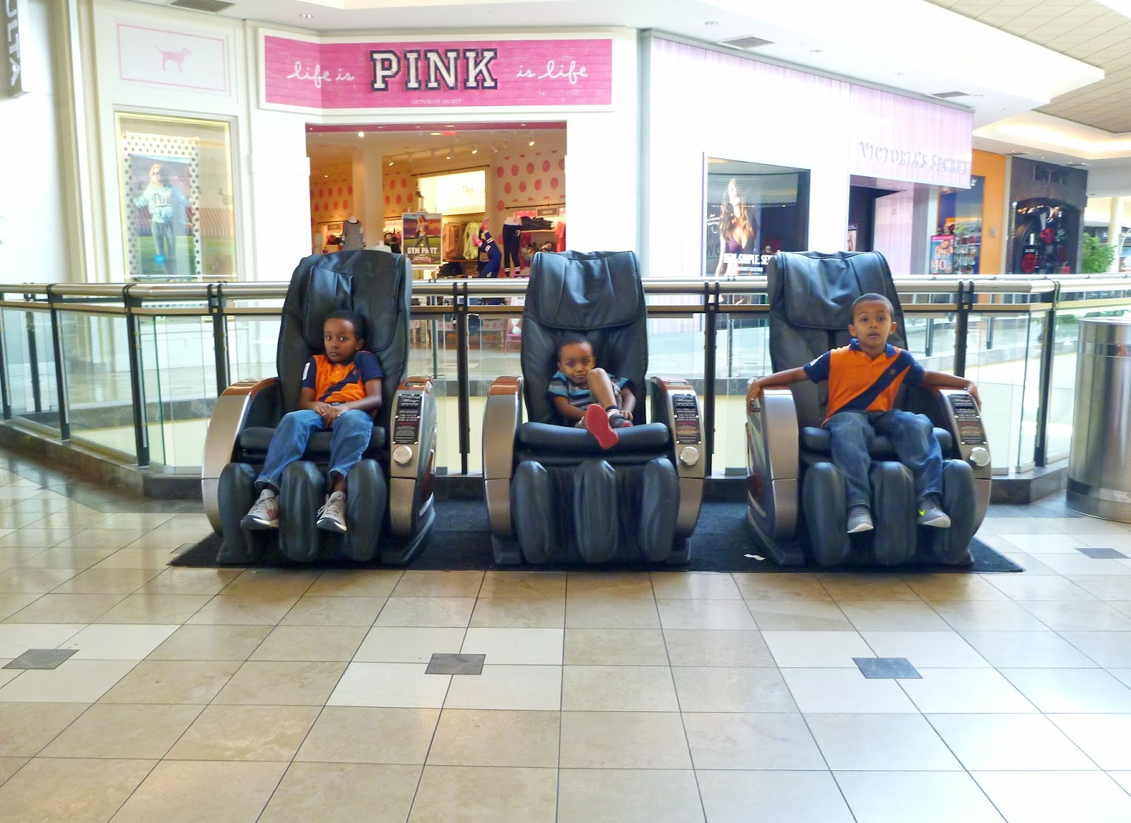 Boys on chairs in shopping mall