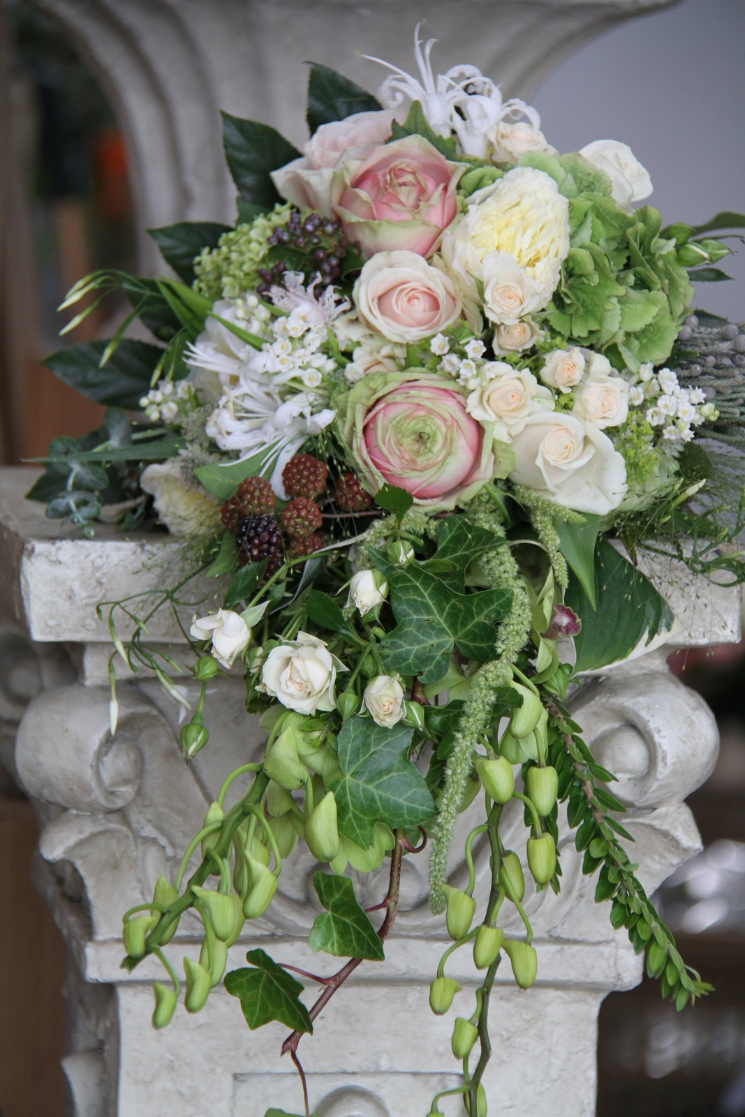 berries roses wedding bouquet spray hydrangea jasmine vine ivy cascade