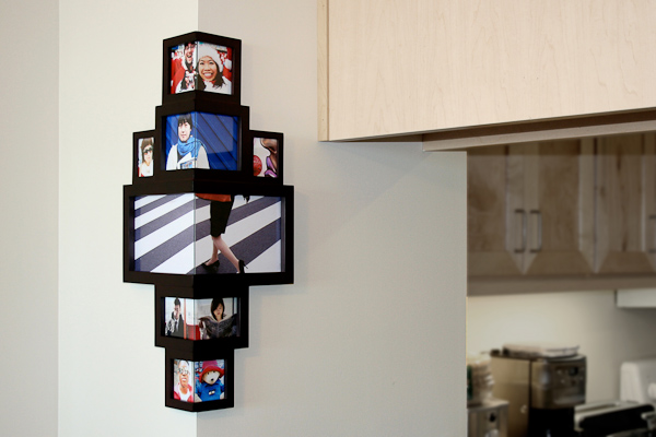 Unusual photo frames hang in the corner amazing pictures for Cool picture frame designs