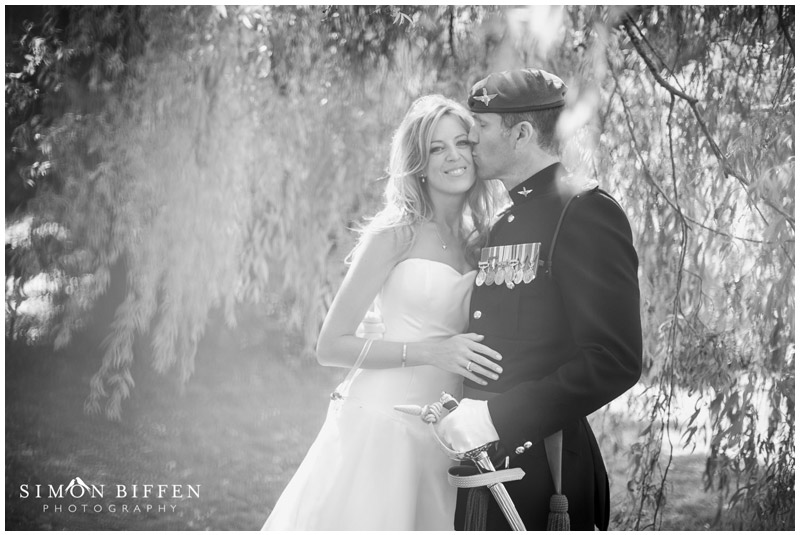 St Donats Castle wedding bride and groom kiss