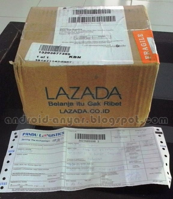 Kardus paket dari Lazada sebelum dibuka beserta resi Pandu Logistics