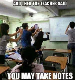 Students taking pictures of white board