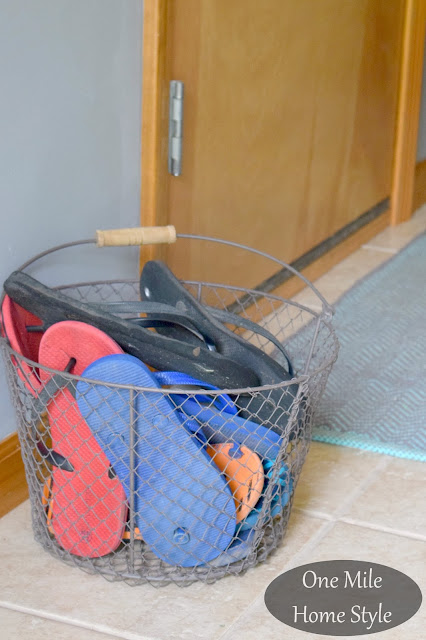 Summer Flip Flop Storage in a Wire Basket - One Mile Home Style