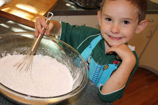 Sammy stirring the dry ingredients.