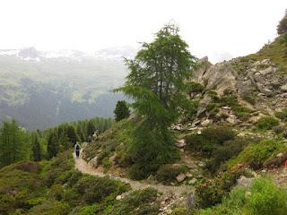 Hiking down into the Sertig valley from the Rinerhorn, near Sertig Dörfli, Switzerland