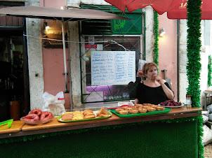 Street side open air restaurants in Alfama district of Lisbon.