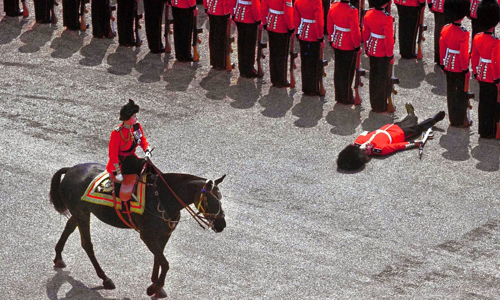 A soldier faints from the heat at a crucial moment during the Trooping the Colour to mark Queen Elizabeth's birthday in 1970.