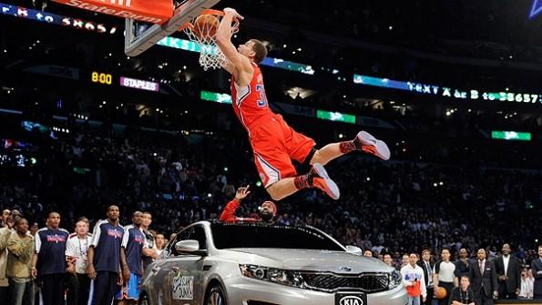 chris paul dunks over dwight howard. dwight howard dunking on