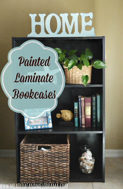 painted black bookcase with aqua blue accessories
