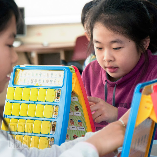 "Students playing ""Guess Who"" during Winter English Camp at Bibong Elementary in Ochang, South Korea."