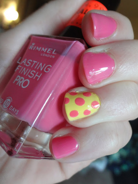 pink and yellow polka dots nails