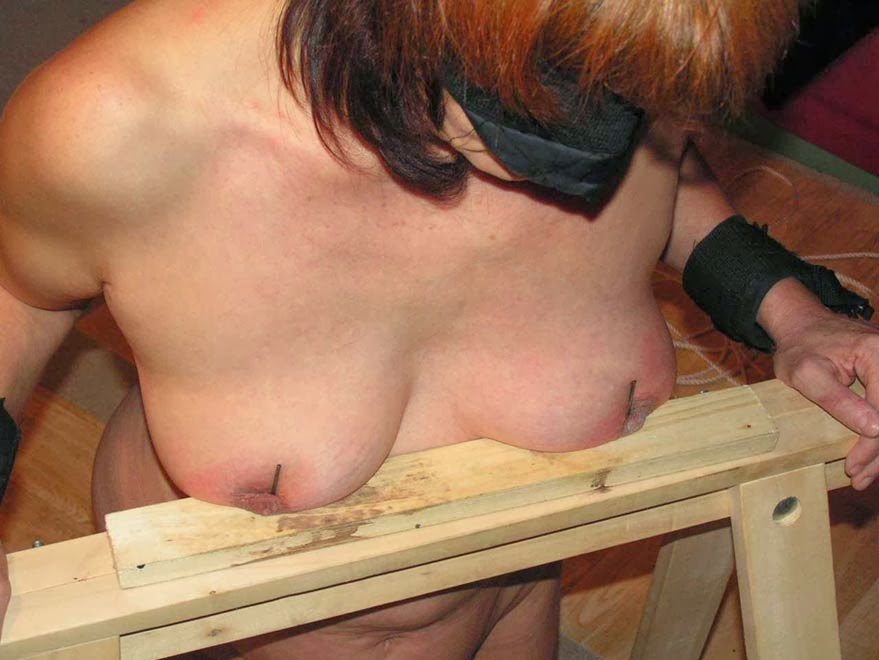 Boobs nailed to wood