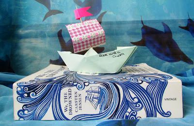 photograph, book cover, Carsten Jensen, We the Drowned, paperback, pretty, sea, ocean, read, Scandinavian, literature, stormy, paper boat, blue, dolphin, waves