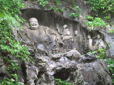 The Laughing Buddha, one of the dozens of reliefs on Feilai Feng