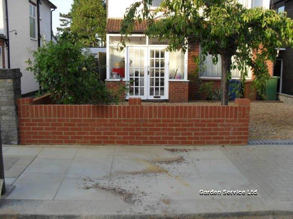 Brick laminate picture brick garden wall construction for Designs for brick garden walls