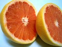 Two halves of a grapefruit.