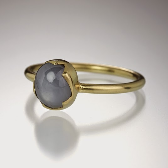 http://www.quadrumgallery.com/jewelry/product/light-blue-star-sapphire-egg-ring