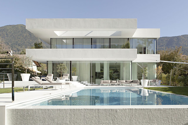 Swimming pool in front of modern dream home