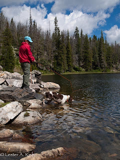 Fisherman and dog at Golden Trout Lake, Montana