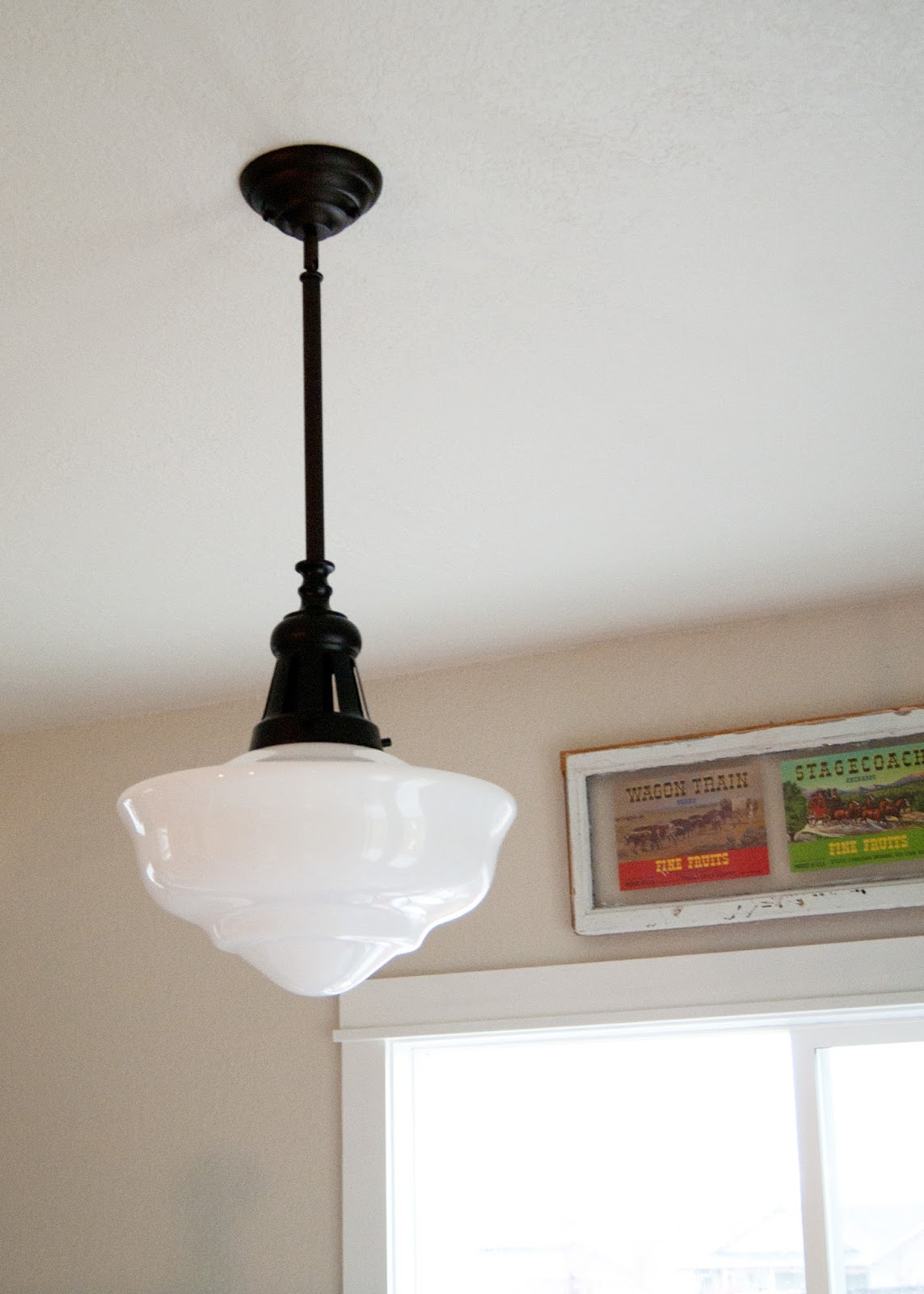 Vintage inspired schoolhouse light in the dining room