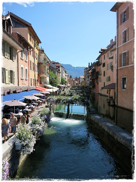 A picturesque flowered canal in Annecy, France.