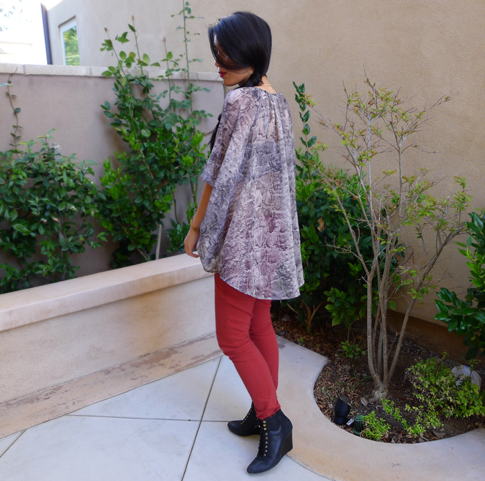 snake print top and red pants
