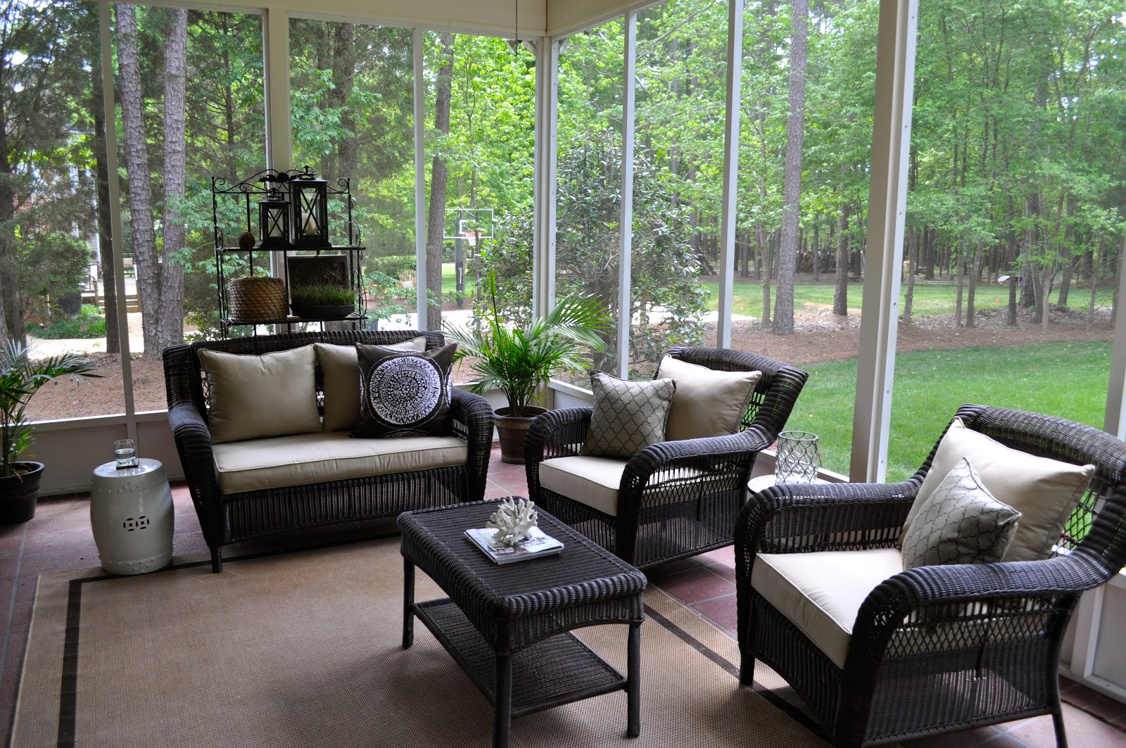 The collected interior our screened porch for Porch furniture