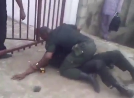 Photos: Two policemen fight in public  5