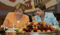 Germany's Chancellor Angela Merkel (L) listens to Brazil's President Dilma Rousseff during a lunch at the Itamaraty Palace in Brasilia, Brazil, August 20, 2015. (Credit: Reuters/Ueslei Marcelino) Click to Enlarge.