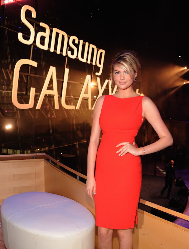 Kate Upton in an orange dress at Samsung Galaxy Note 10.1 Launch Event