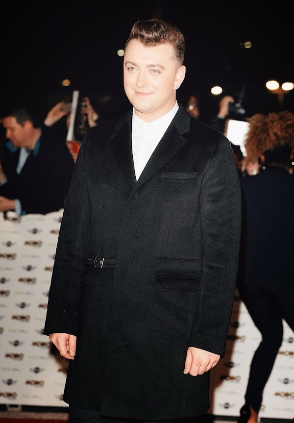 Sam Smith wears Pringle Of Scotland half belted coat to MOBO Awards in London October 2014