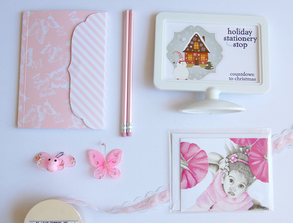 Pink note pad and matching pencils, white plastic sign, pink girl 3 note card from The True colors collection with pink ribbon and pink butterflies