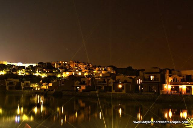 The Cove Rotana's Mediterranean-inspired village at night
