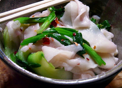Stretching Noodles with Green Onion and Chili Pepper