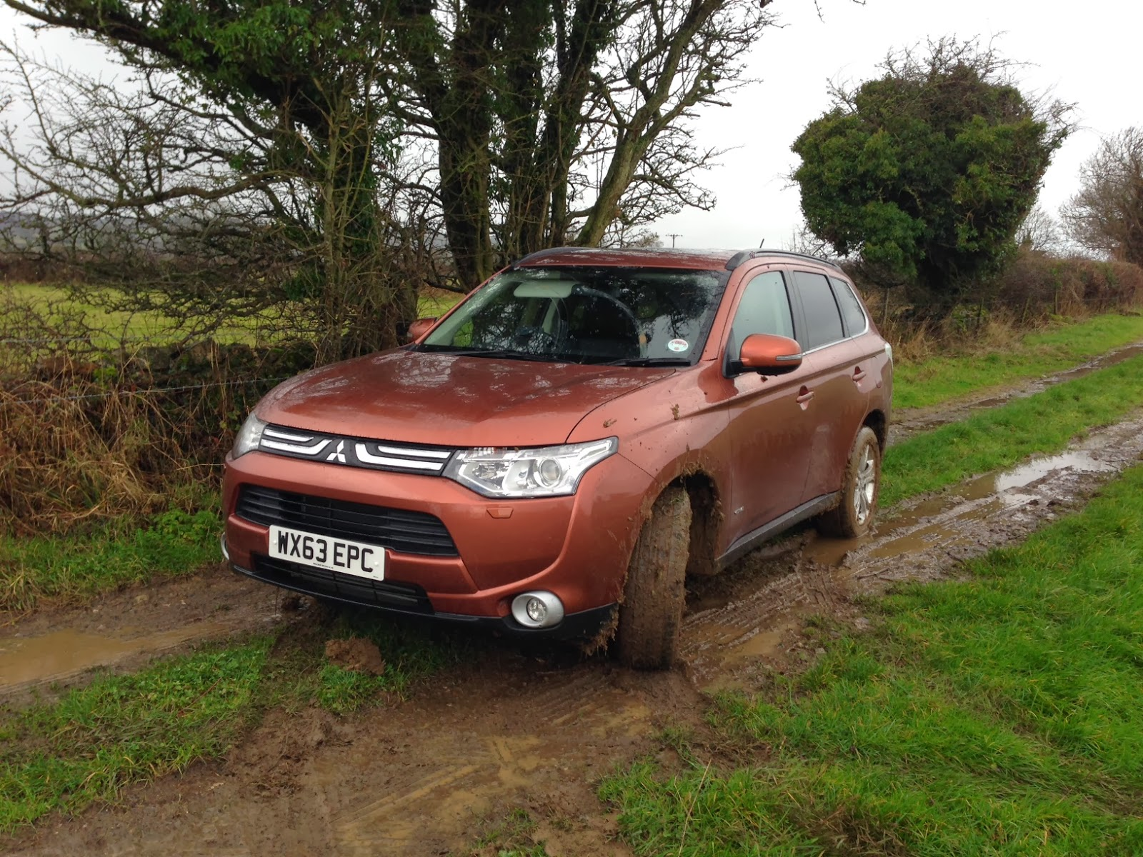 The Mitsubishi Outlander parked up after 'the incident' in the mud