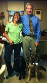 Sendero and his trainer, Jan Abbot, with Mike May and his guide dog Tank