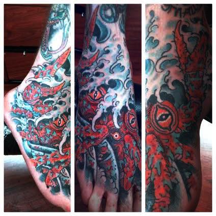 Seamonster foot tattoo by tattoo artist Jason Kunz for Triumph Tattoo