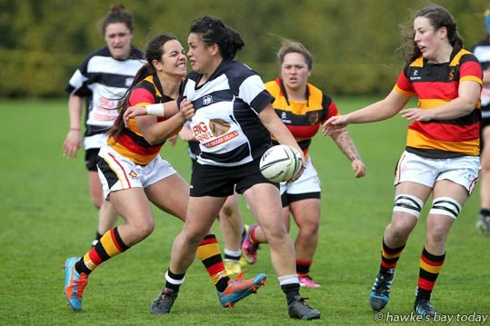 With ball: Sylvia Bockman, Hawke's Bay Tuis - women's rugby vs Waikato at Park Island Napier. Waikato won 43-3 photograph