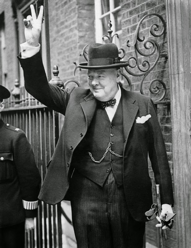 """Churchill V sign HU 55521"" by British Government - This is photograph HU 55521 from the collections of the Imperial War Museums. Licensed under Public domain via Wikimedia Commons - http://commons.wikimedia.org/wiki/File:Churchill_V_sign_HU_55521.jpg#mediaviewer/File:Churchill_V_sign_HU_55521.jpg"