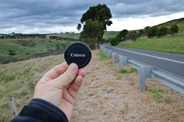 holding canon lens cap next to bulla-diggers rest road