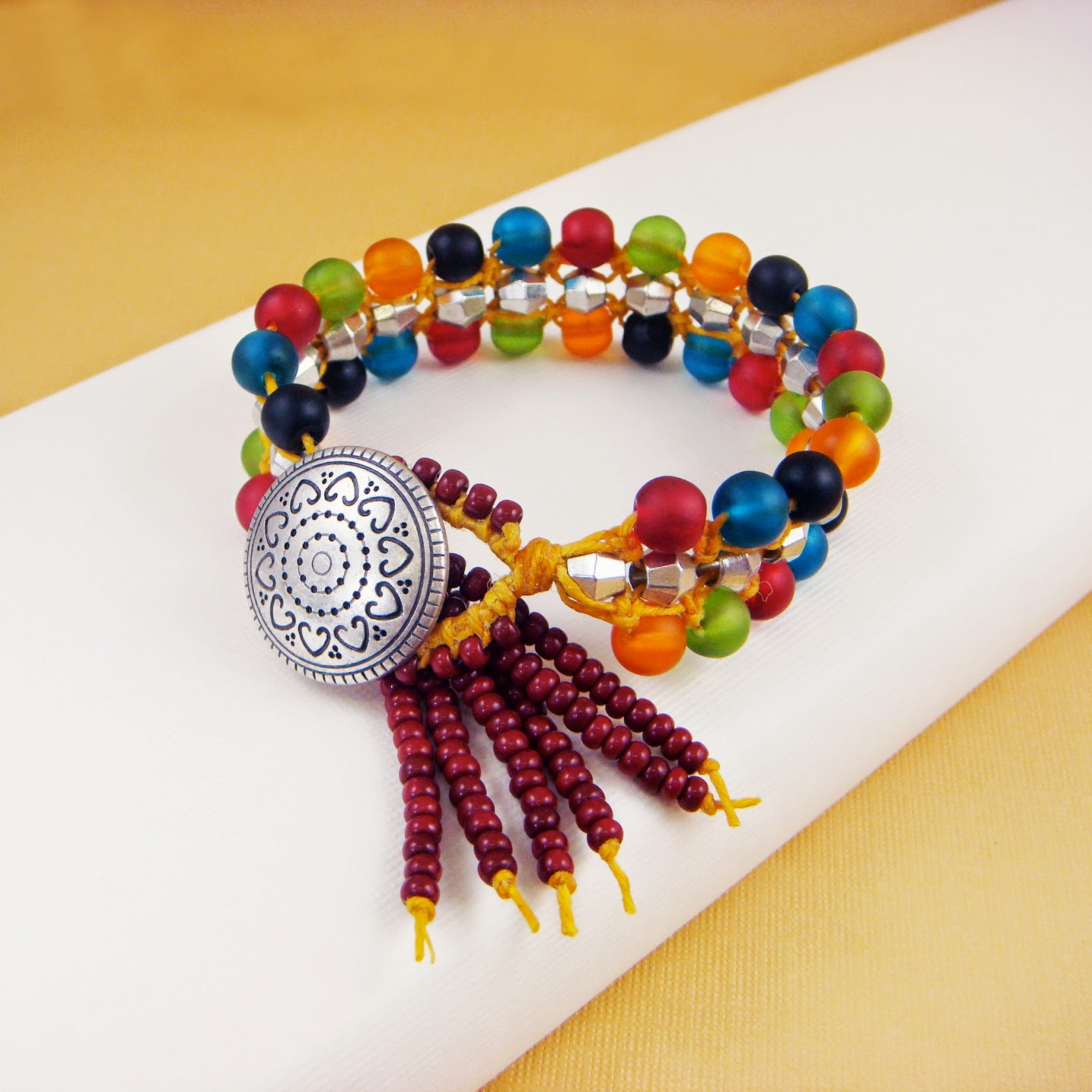 http://www.bostonbeadcompany.com/collections/project-classes/products/spice-trader-macrame-bracelet-by-erin-siegel